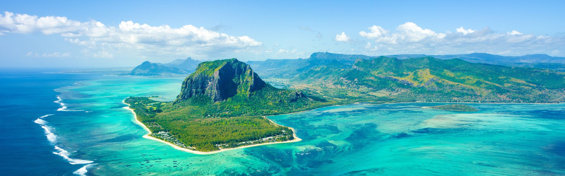 The republic of Mauritius comprises of several islands located in the south-east of the Indian Ocean. The main island is 2,000 kilometers away from the eastern coast of Africa. Foreigners thoroughly enjoy its beaches and sea as well as its culture. Mauritians are welcoming and different cultures coexist peacefully here. While the island has evolved and kept up with the needs of modern times, it has not let go of its roots.